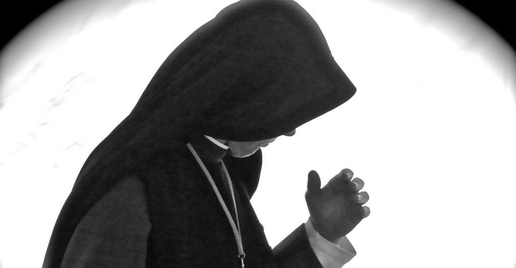 Nun in deep prayer
