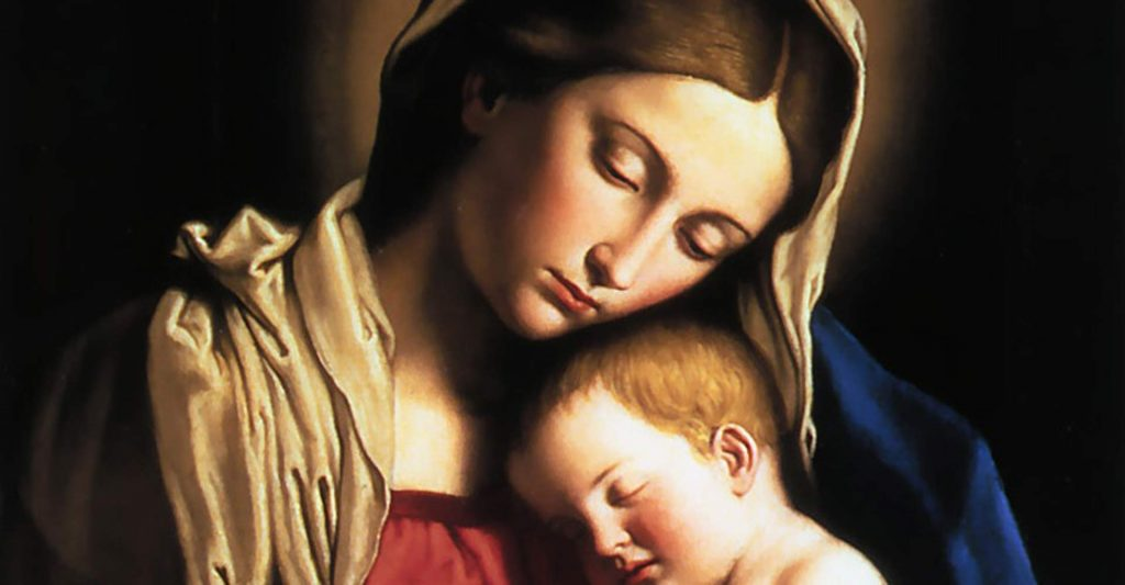 Mary holds the infant Jesus